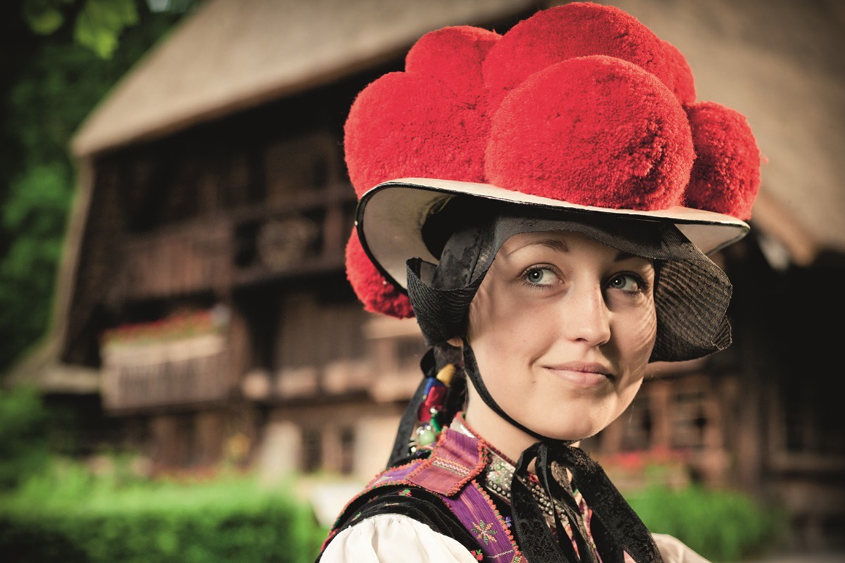 young woman wearing the famous red bubblehat