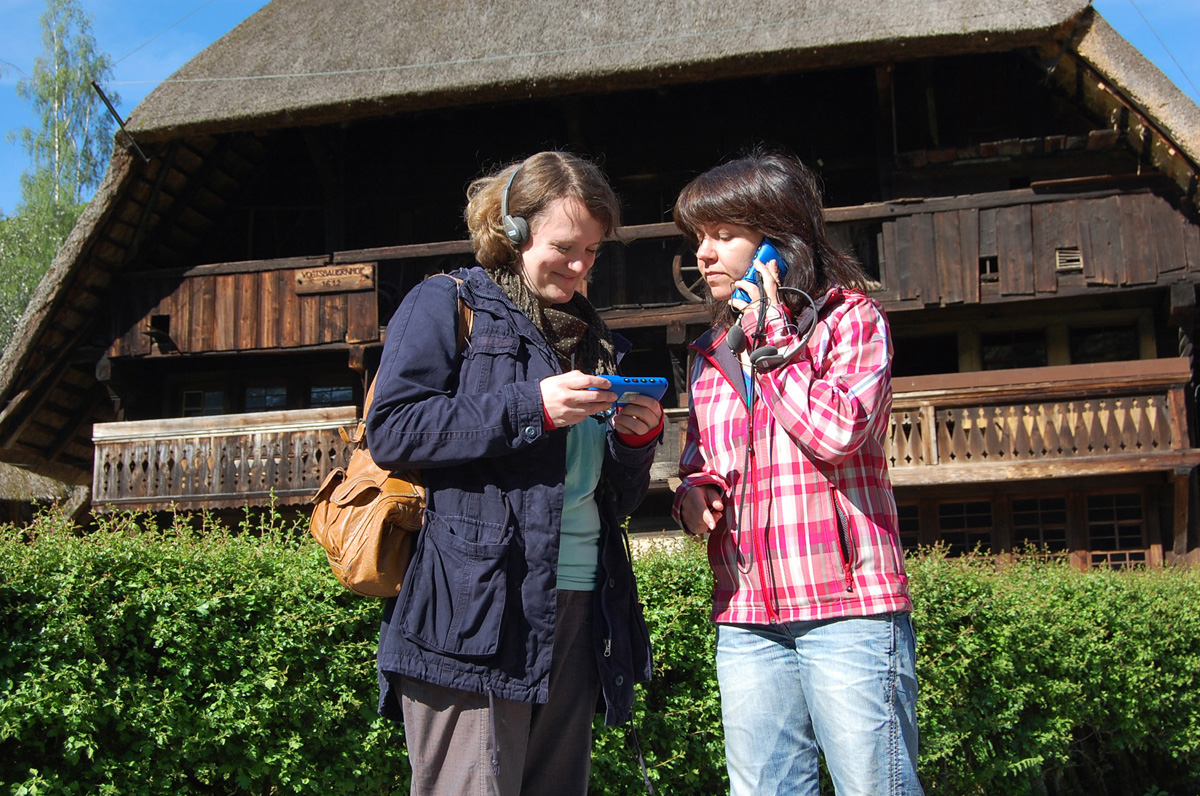 Two women using the audioguide
